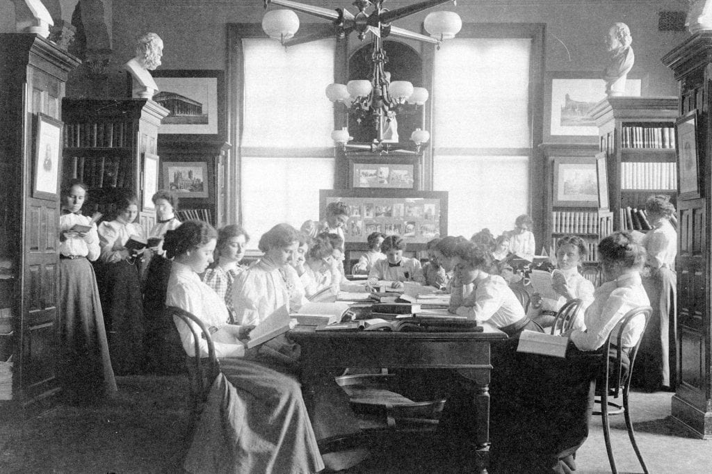 Group of young women reading in library of normal school, Washington, D.C.