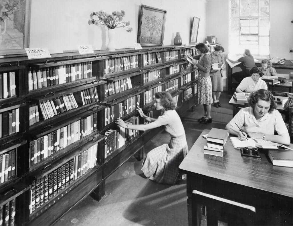 vintage photo of women researching in library